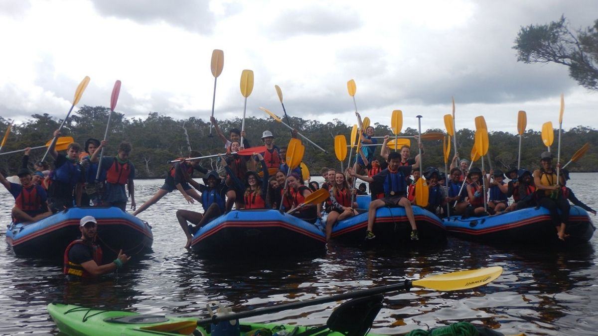 Students in boats on an expedition journey